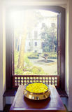 Yellow flowers and open window Stock Photo