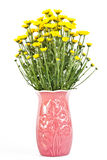 Yellow flowers in a vase . Stock Photo
