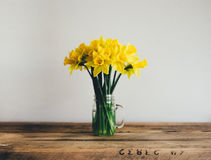Yellow Flowers in Vase on Table Stock Images