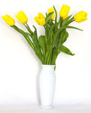 Yellow flowers in a vase Royalty Free Stock Images