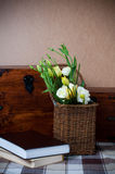 Yellow flowers in a wicker basket Stock Photo