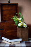 Yellow flowers in a wicker basket Stock Images