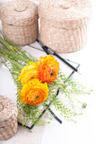 Yellow Flowers, Wicker Baskets And A Notebook Royalty Free Stock Image