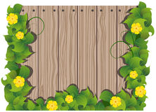 Yellow flowers and wooden fence Royalty Free Stock Photography