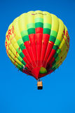 Yellow flying balloon Royalty Free Stock Image