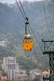 Yellow flying cabinet. A yellow cabinet of the cable car system flying between the beautiful city of jounieh , Beirut,Lebanon Royalty Free Stock Image