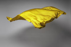Yellow flying fabric Royalty Free Stock Images