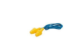 Ear Plugs. Yellow foam ear plugs with blue wire, uncoiled Stock Image