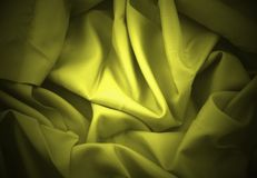 Yellow folded satin Stock Photo
