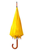 Yellow folded umbrella Stock Image