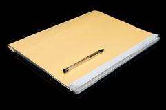 Yellow folder and pen Stock Images