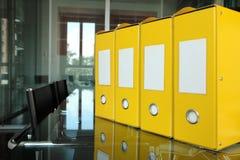 Yellow folders. Row of yellow folders on desk in office Stock Image
