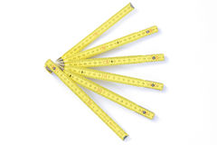 Yellow folding measuring stick Royalty Free Stock Image