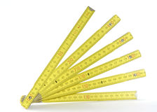 Yellow folding measuring stick Stock Image
