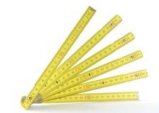 Yellow folding measuring stick Stock Image
