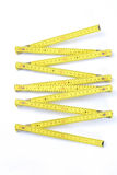 Yellow folding measuring stick Royalty Free Stock Photo