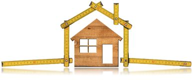 Model House and Wooden Folding Ruler royalty free stock image