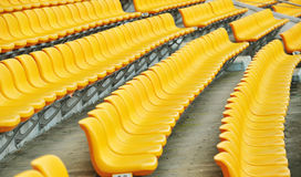 Yellow football seats Royalty Free Stock Images