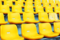 Yellow football seats Stock Photo