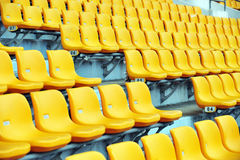 Yellow football seats Stock Photography