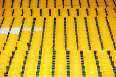 Yellow football seats Stock Images
