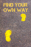 Yellow footsteps on sidewalk towards Find your own way message Stock Photo