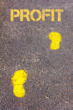 Yellow footsteps on sidewalk towards Profit message Royalty Free Stock Images