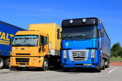 Yellow Ford Cargo 1830 and Renault Magnum Semi Trucks royalty free stock photos