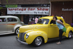 Yellow Ford 1940, and a woman with glasses Royalty Free Stock Photography