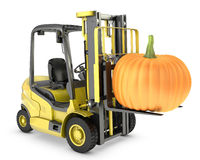 Yellow fork lift truck lifts orange pupmkin Royalty Free Stock Photos