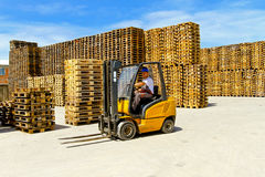 Yellow forklift Stock Image
