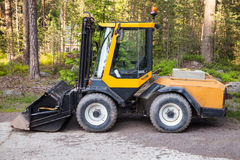Yellow forklift with general bucket stands Royalty Free Stock Photo