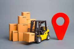Yellow Forklift truck with cardboard boxes and a red position pin. Locating packages and goods. Algorithm for constructing royalty free stock photos