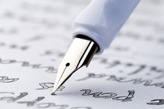 Yellow fountain pen writing a letter stock photography
