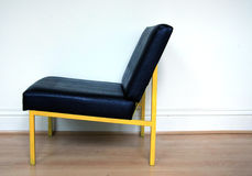 Yellow framed chair Royalty Free Stock Photo