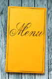 Yellow framed menu book on wood Stock Images