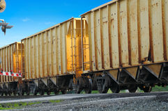 Yellow freight cars. Rusty, yellow freight cars passing over a grade crossing Royalty Free Stock Photo