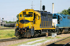 Yellow Freight Train. A Freight Train Rounding a bend into a rail yard Stock Image