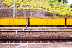 Yellow freight train box cars in perspective Stock Photo