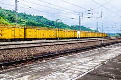 Yellow freight train box cars in perspective Stock Photography