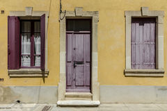 Yellow french house with red shutters. At french small town southern France Royalty Free Stock Photos