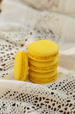 Yellow French macaron on vintage doily Stock Images