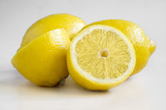 Yellow, fresh lemons. Some yellow, ripe and fresh lemons are on the white background Stock Image