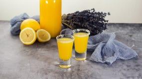 Yellow fresh shot cocktail or lemonade with lemon royalty free stock photo