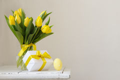 Yellow, fresh tulips in a vase on a wooden table. Gift and Easte Royalty Free Stock Photo