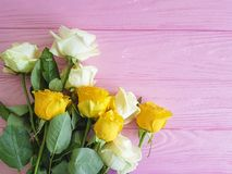 Yellow rose on pink wooden place for text vintage festive freshness summer Stock Photo