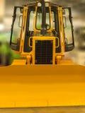 Yellow excavator bucket. Yellow front bucket of heavy crawler excavator Stock Image