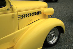 Yellow front end. Front end of a classice care with fender and tire stock photography