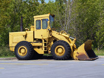Yellow front end loader. A front end loader parked for the weekend royalty free stock photography
