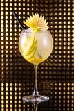 Yellow fruit cocktail with lemon in tall round glass royalty free stock photo